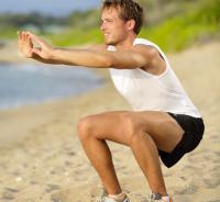 squats on beach