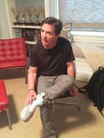 Michael J. Fox trying on real self-lacing Nike Mags. Funds from the shoes (which are due for sale in 2016) will go to the Michael J. Fox Foundation to help combat Parkinson's disease.